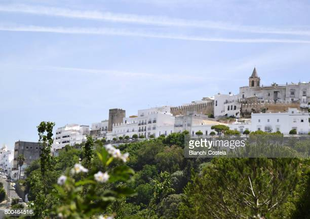 Vejer de la Frontera in the mountains and with the tower of the church on the top