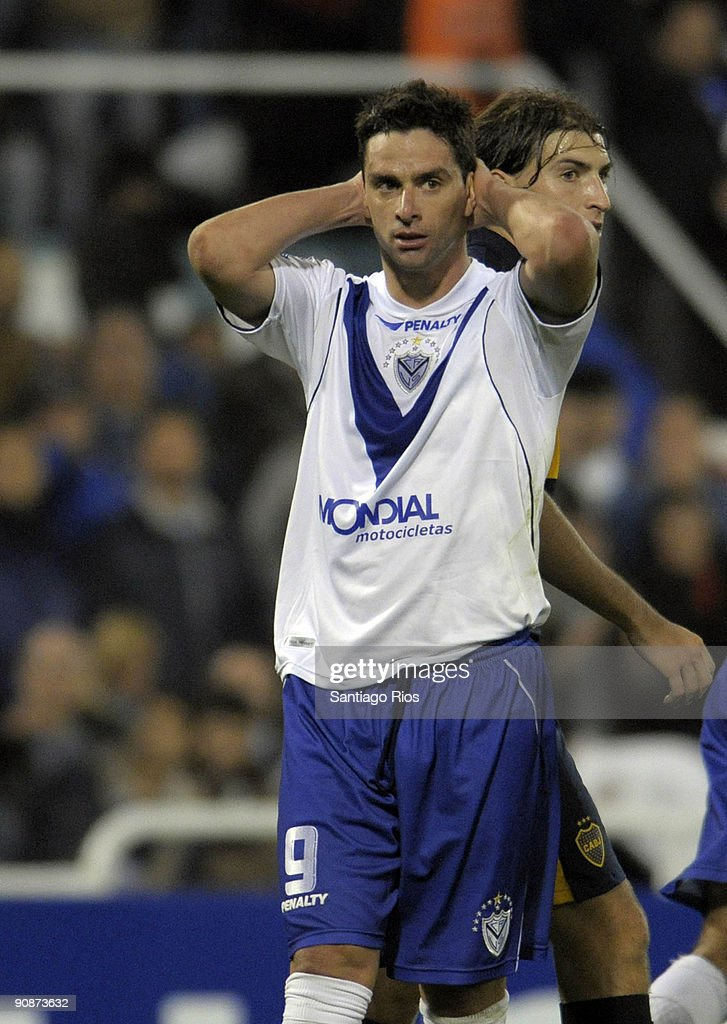 Velez Sarsfield's player <a gi-track='captionPersonalityLinkClicked' href=/galleries/search?phrase=Rodrigo+Lopez&family=editorial&specificpeople=216384 ng-click='$event.stopPropagation()'>Rodrigo Lopez</a> reacts in lament during a Copa Sudamericana 2009 soccer match against Boca Juniors on September 16, 2009 in Buenos Aires, Argentina.