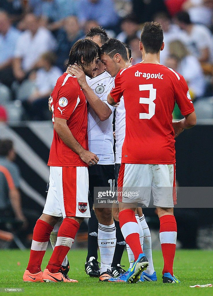 Veli Kavlac of Austria stands head to head with <a gi-track='captionPersonalityLinkClicked' href=/galleries/search?phrase=Mesut+Oezil&family=editorial&specificpeople=764075 ng-click='$event.stopPropagation()'>Mesut Oezil</a> of Germany during the FIFA 2014 World Cup Qualifying Group C match between Germany and Austria Allianz Arena on September 6, 2013 in Munich, Germany.
