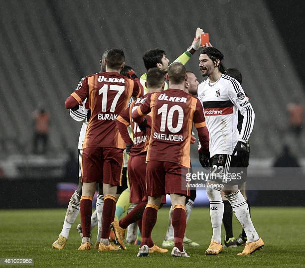 Veli Kavlak of Besiktas is shown a red card by referee Cuneyt Cakir after fouling Wesley Sneijder of Galatasaray during the Turkish Spor Toto Super...