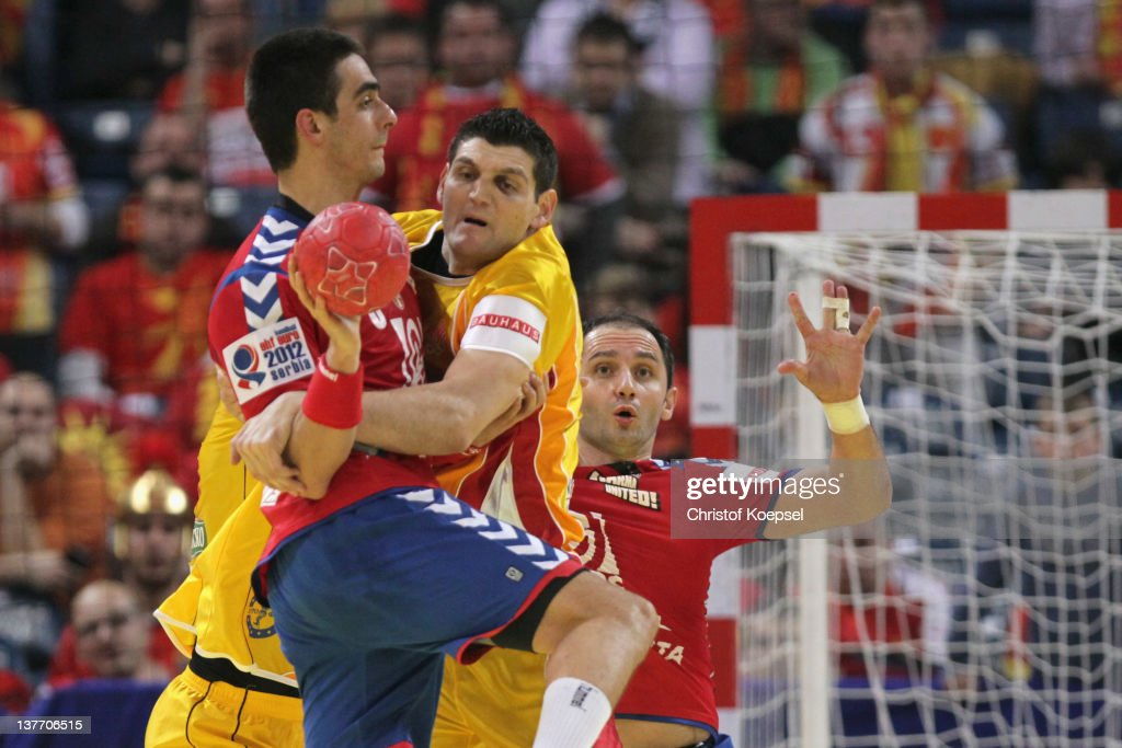 Velko Markoski of Macedonia (R) defends against Zarko Sesum of Serbia (L) during the Men's European Handball Championship second round group one match between Serbia and Macedonia at Beogradska Arena on January 25, 2012 in Belgrade, Serbia.