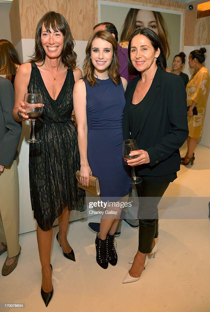 Velvet designer Toni Spencer, actress Emma Roberts and Velvet Designer Jenny Graham attend the opening of the Velvet by Graham & Spencer store on June 6, 2013 in Brentwood, California.