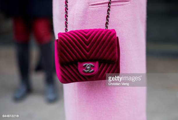A velvet red Chanel bag outside during Milan Fashion Week Fall/Winter 2017/18 on February 23 2017 in Milan Italy