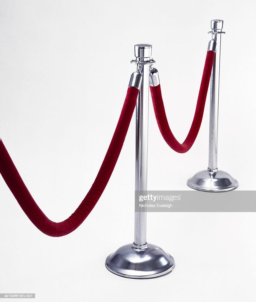 Velvet rope on white background : Stock Photo