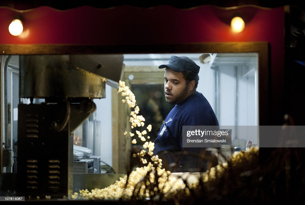 A vender watches popcorn pop at the Smithsonian's National Zoo December 29, 2010 in Washington, DC. The National Zoo decorated its main walk with holiday lights and other decorations for its yearly Zoo Lights celebration.