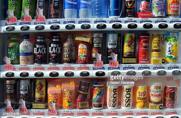 A vending machine along a sidewalk in Tokyo offers a variety of canned and bottled beverages