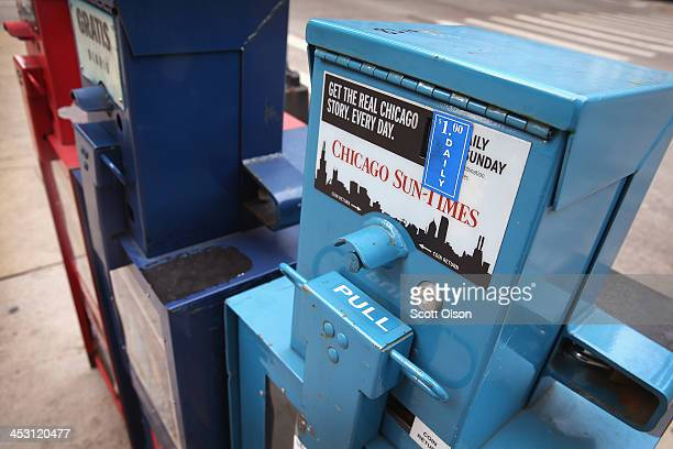A vending machine sells Chicago SunTimes newspapers on a street corner in the Loop on December 2 2013 in Chicago Illinois Guild member are expected...