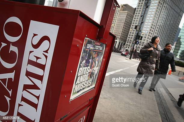 A vending machine which accepts credit cards sells Chicago SunTimes newspapers on a street corner in the Loop on December 2 2013 in Chicago Illinois...