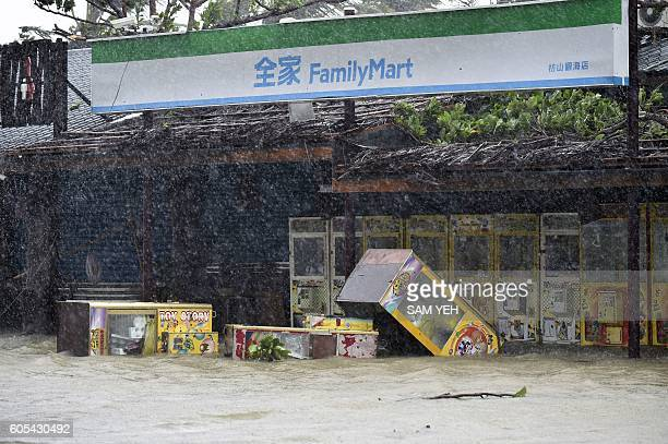 Vending machines stand in floodwaters outside a convenience shop as super typhoon Meranti skirts Pingtung county in southern Taiwan on September 14...