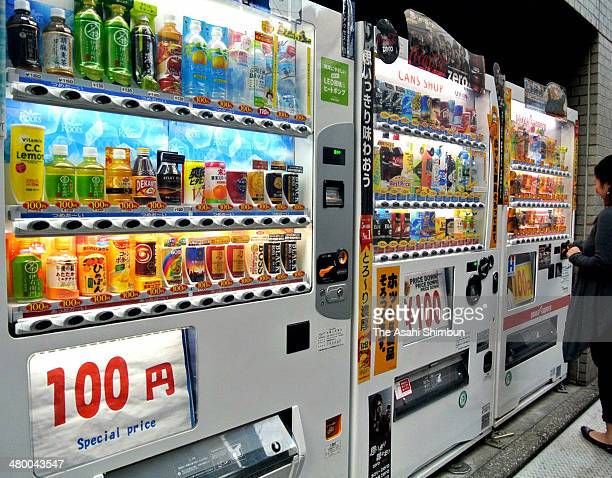 Vending machines which sells all bevarages at 100 Japanese yen are arranged at a street on November 22 2013 in Tokyo Japan Japan raises consumption...