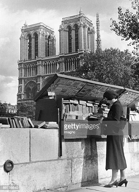 Vending stand in front of Notre Dame in Paris Photograph Around 1930