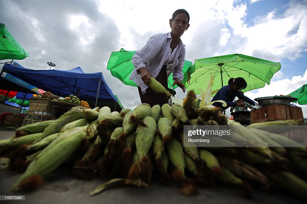 A vendor arranges ears of corn at a market stall in Naypyidaw, Myanmar, on Friday, June 7, 2013. President Thein Sein has allowed more political freedom and loosened economic controls since coming to power two years ago, prompting the U.S. and other nations to ease sanctions. Photographer: Dario Pignatelli/Bloomberg via Getty Images