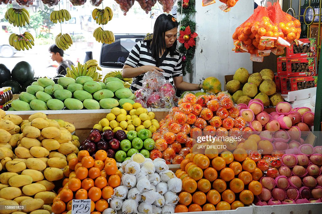 A vendor arranges goods at her fruit stall in Manila on January 4, 2013. The Philippines' inflation rate fell to a five-year low last year, the government said Friday, helping efforts to hold down interest rates and boost economic growth. Consumer prices expanded by 3.2 percent for the entire 2012, substantially lower than the 4.6 percent recorded in 2011, the National Statistics Office said.