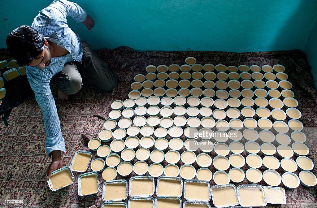 A vendor arranges phirini (a dessert made with flour, condensed milk and other ingredients) bowls at his home to sell them to customers later during Iftar (or breaking of fast) on the first day of Ramadan on July 11, 2013 in Srinagar, the summer capital of Indian administered Kashmir, India. Ramadan is the ninth month of the Islamic lunar calendar, during which Muslims believe the Quran was given to Prophet Muhammad. Muslims across the globe abstain from eating, smoking, and sex from dawn to dusk during the month. Besides spending more time praying, donating alms is mandatory. Every Muslim has to give 2.5 percent of their wealth and assets to the poor, and often give more.