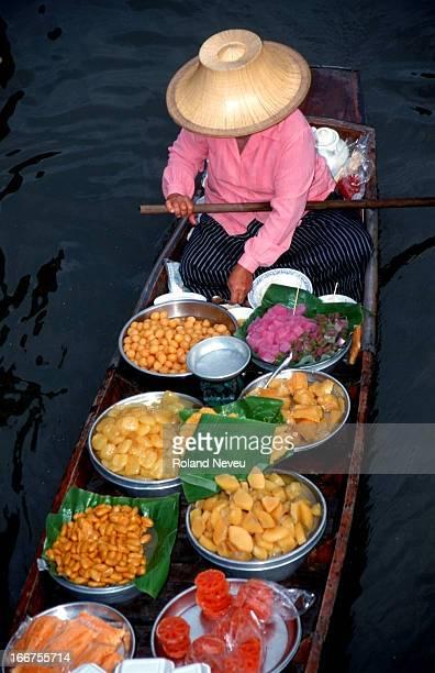A vendor at the Saduak floating market Bangkok