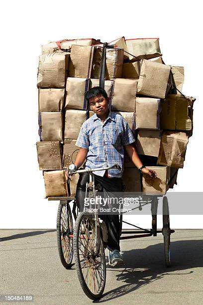 Vendor carrying boxes on his bicycle in Kathmandu