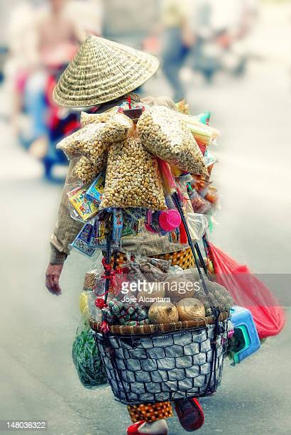 Vendor carrying goods