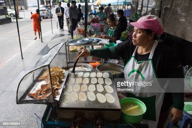 A vendor cooks crepes on a hotplate at a food stall in the Phaya Thai District of Bangkok Thailand on Wednesday April 5 2017 The central...