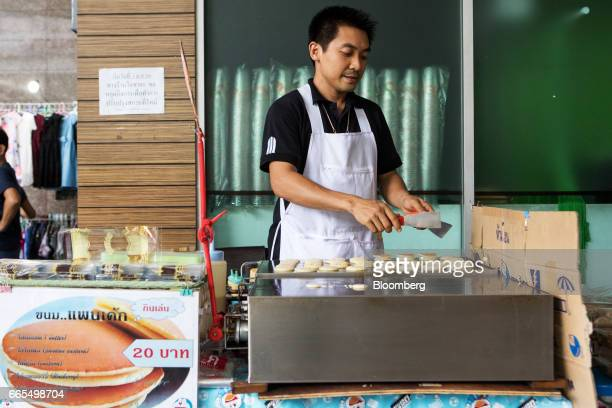 A vendor cooks pancakes on a hotplate at a food stall in the Phaya Thai District of Bangkok Thailand on Wednesday April 5 2017 The central...