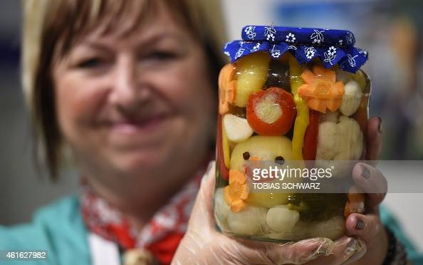 A vendor displays a glass of mixed pickles at the booth of Hungary during the opening day of the 'Gruene Woche' agricultural fair on January 16 2015...