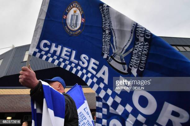 A vendor displays Chelsea flags and scarves before the English Premier League match between West Bromwich Albion and Chelsea at The Hawthorns stadium...