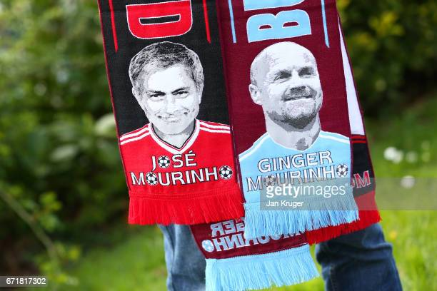 A vendor displays scarves for sale outside the stadium before the Premier League match between Burnley and Manchester United at Turf Moor on April 23...