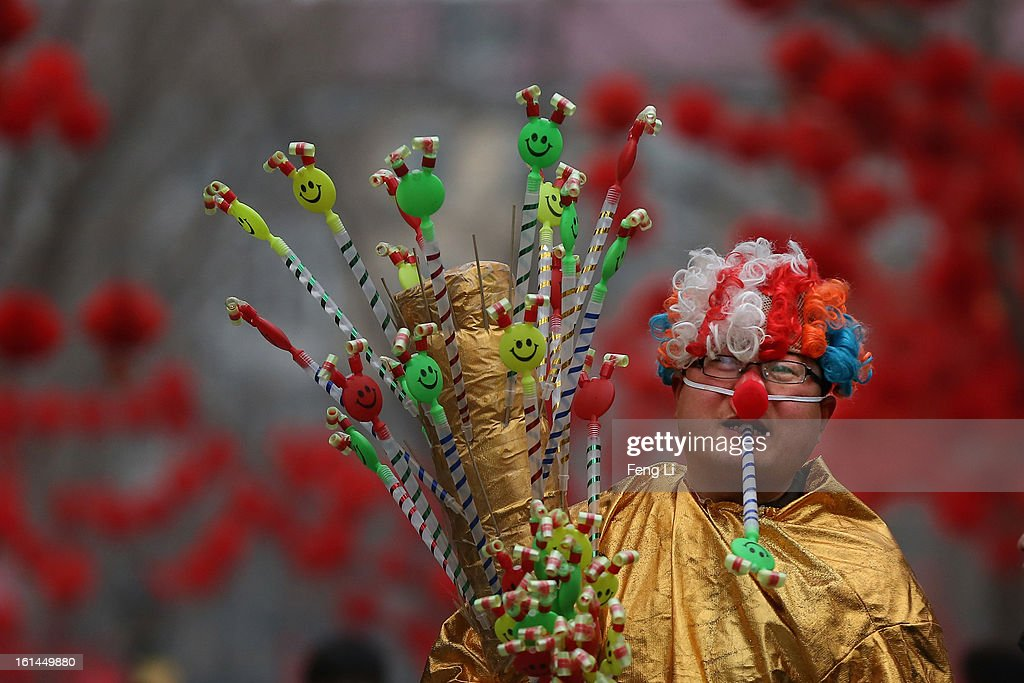 A vendor dresses as a clown at a Spring Festival Temple Fair for celebrating Chinese Lunar New Year of Snake on February 11, 2013 in Beijing, China. The Chinese Lunar New Year of Snake also known as the Spring Festival, which is based on the Lunisolar Chinese calendar, is celebrated from the first day of the first month of the lunar year and ends with Lantern Festival on the Fifteenth day.