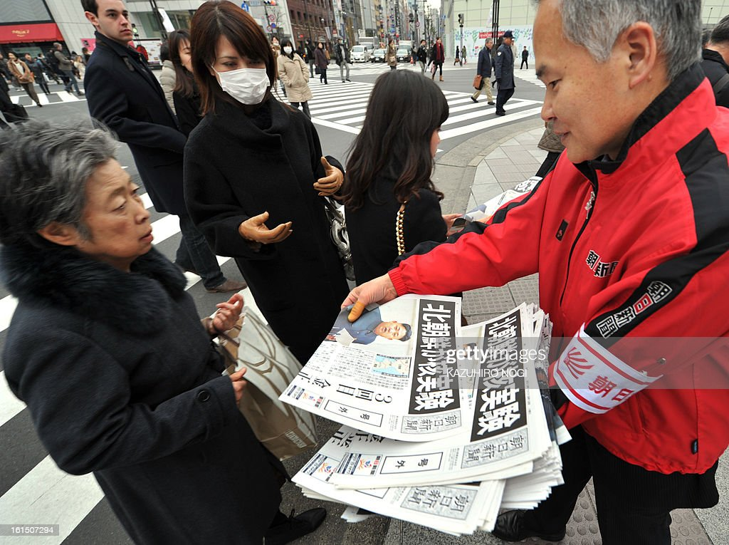 A vendor (R) hands out extra edition newspapers to pedestrians reporting on North Korea's nuclear test, in downtown Tokyo on February 12, 2013. North Korea's nuclear test is a 'grave threat' to Japan, Prime Minister Shinzo Abe said on February 12, hours after Pyongyang confirmed it had successfully detonated an atomic device.