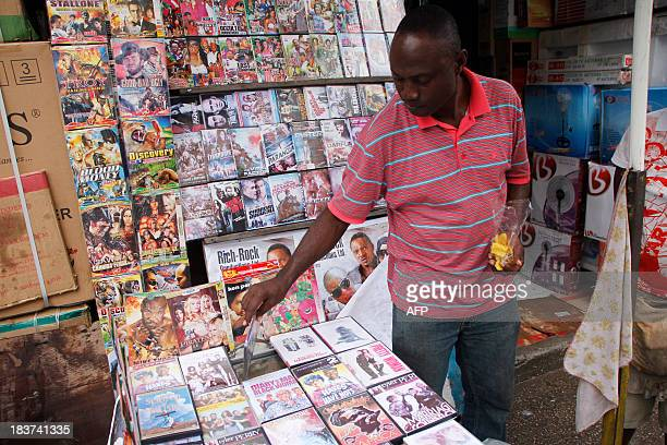 DVD vendor holds a DVD in front of his store on September 24 2013 in Accra The new film by GhanaianNigerian director Pascal Amanfo 'Boko Haram' has...