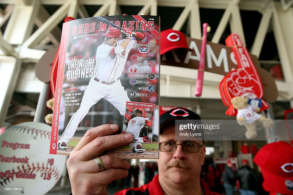 A vendor holds a souvenir program before the start of the Los Angeles Angels of Anaheim game against the Cincinnati Reds at Great American Ball Park on April 1, 2013 in Cincinnati, Ohio.
