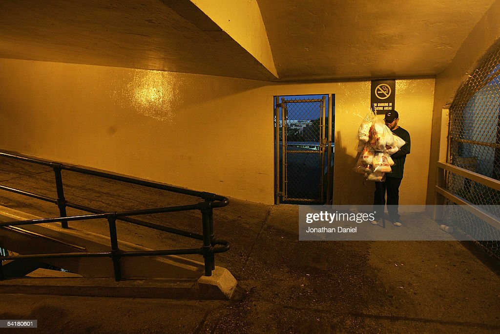 A vendor holds cotton candy as he stands on a ramp in the stadium after the game between the Los Angeles Dodgers and the Chicago Cubs on August 30, 2005 at Wrigley Field in Chicago, Illinois. The Cubs defeated the Dodgers 6-3.