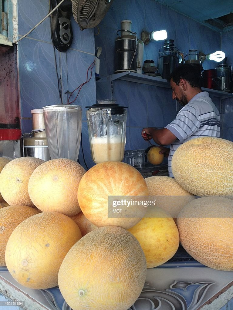 A vendor in Baghdad chops up cantaloupe to make fresh juice. Despite the fierce fighting in northern and western Iraq, war-hardened Baghdad residents still go about their lives, crowding the city's bazaars, restaurants, malls and parks. But they don't expect the calm to last.