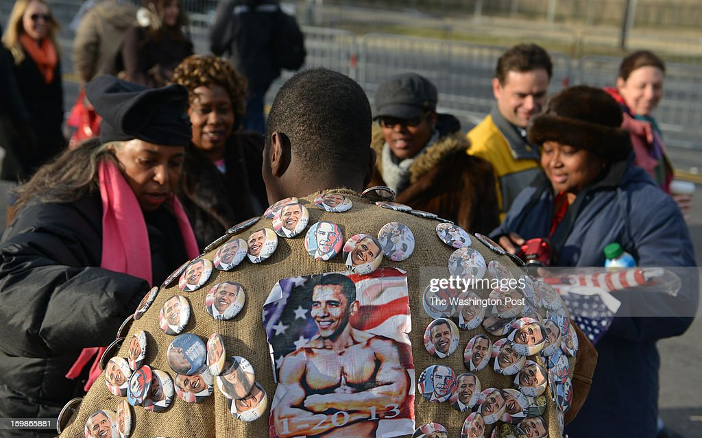 Vendor 'LJ' of Brooklyn, NY, sells Obama buttons to Jessica Stewart (Mt. Julie, TN), Janet Porter (St Louis, MO), Krystal Ross (Nashville, TN) and Beverly Lewis (Nashville), near the National Mall for the second term inauguration for U.S. President Barack Obama on Monday, January 21, 2012, in Washington, DC.