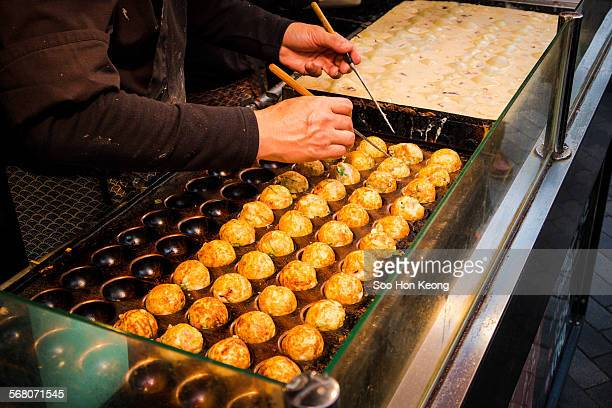 A Vendor making Takoyaki in Osaka, Japan