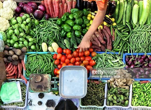 Vendor man selling fresh vegetables