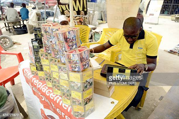 A vendor of Nigeria's leading cellphone provider tries to register a SIM card at Ibafo Ogun State on May 25 2015 Telecoms operators said at the...