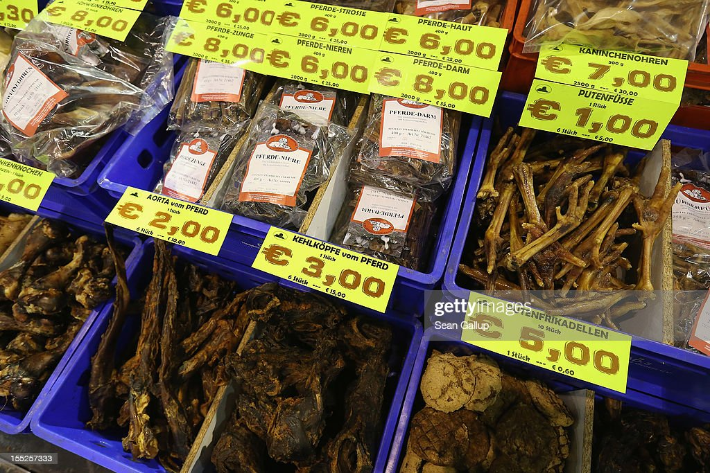A vendor of snacks for pet dogs sells dried horse aortas, dried horse throats, dried turkey feet and other delights at the pet trade fair (Heimtiermesse) at Velodrom on November 2, 2012 in Berlin, Germany. Exhibitors are showing the latest trends in collars, snacks and other accessories for cats, dogs and other household pets.