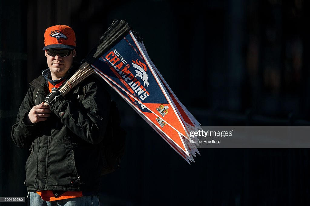 A vendor offers pennants for sale before a victory parade for the Denver Broncos after Super Bowl 50 on 17th Street on February 9, 2016 in Denver, Colorado.