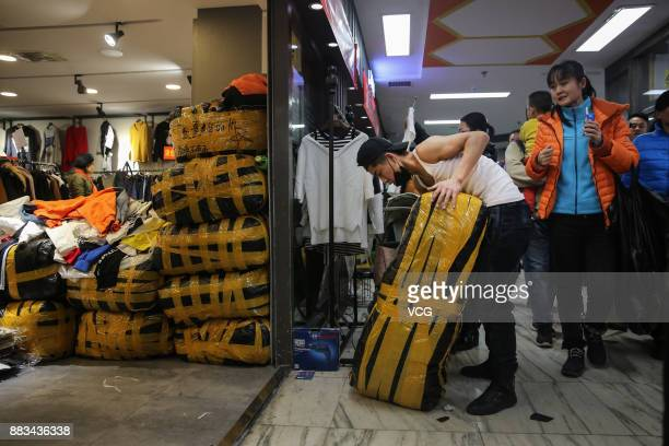 A vendor packs before leaving the Dongding wholesale market on November 30 2017 in Beijing China The Dongding market the last of 12 clothing...