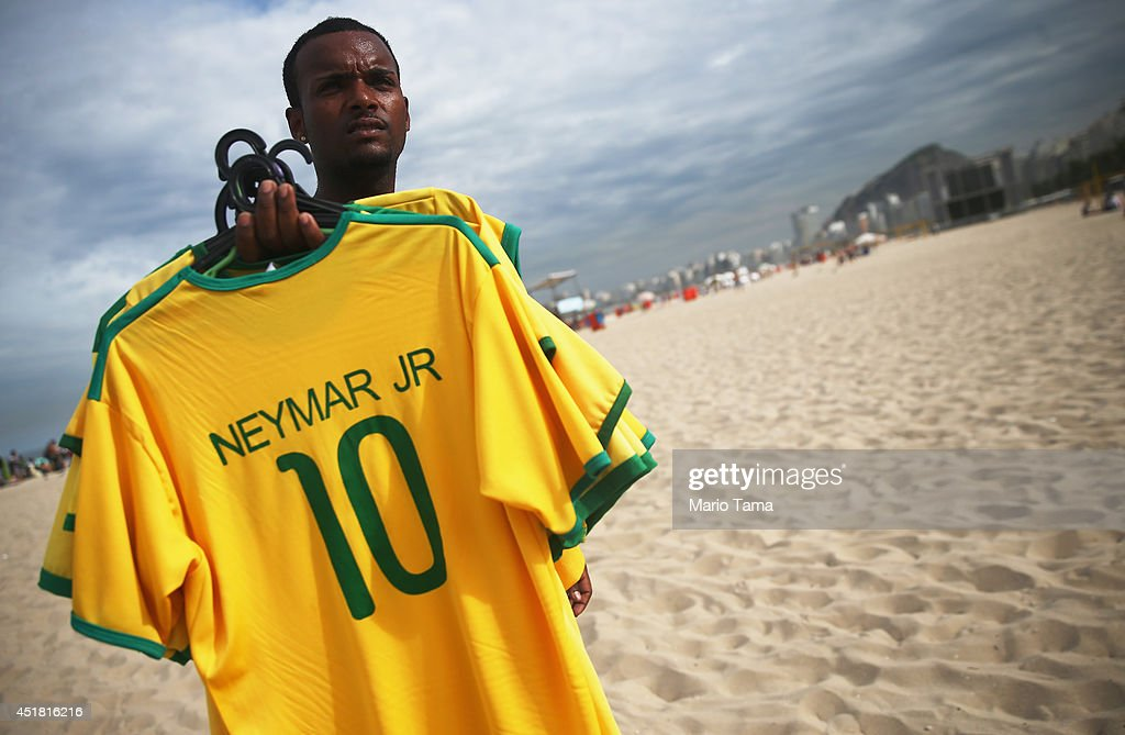 A vendor poses selling Neymar jerseys on Copacabana Beach on July 7, 2014 in Rio de Janeiro, Brazil. Brazil plays Germany tomorrow in the first semi-final match of the 2014 FIFA World Cup.