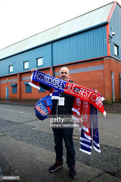 A vendor poses with scarves for sale outside the stadium before the FA Cup Third Round match between Rochdale and Nottingham Forest at Spotland...