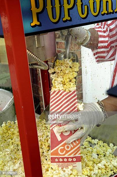 Vendor pouring popcorn