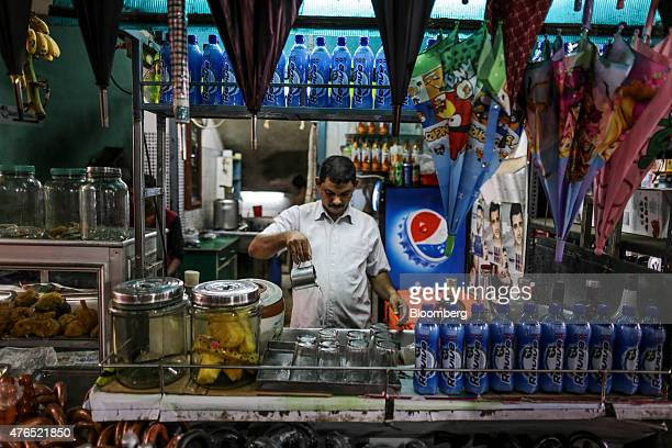 A vendor pours water at a tea stall in Cochin India on Thursday May 28 2015 Prime Minister Narendra Modi is counting on a revival in credit to...