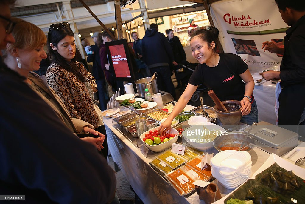 A vendor prepares a papaya salad as visitors look on on the first day of Street Food Thursday at the Markthalle Neun market hall in Kreuzberg district on April 11, 2013 in Berlin, Germany. Street Food Thursday features sidewalk delicacies from a variety of culinary traditions and will be open every Thursday from 5 until 11. Berlin has become a major tourist destination in Europe and has developed a reputation as a hip, affordable and open-minded city.
