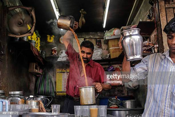 A vendor prepares chai at a stall in Mumbai India on Friday Sept 25 2015 That sweet and milky tea concoction called chai is getting an image makeover...