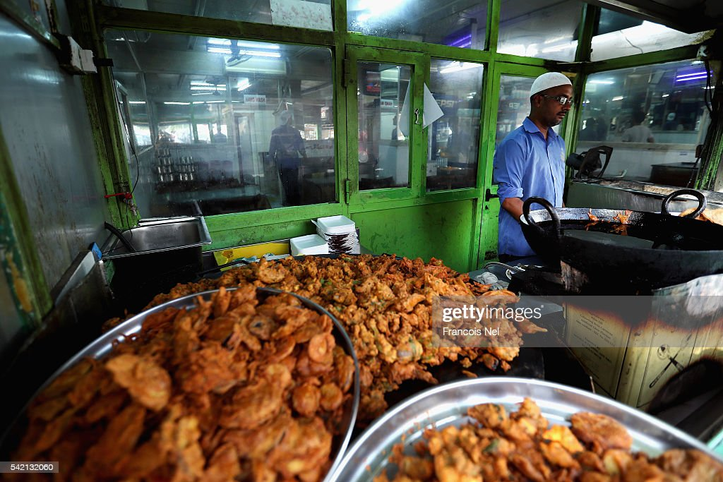A vendor prepares food during the holy month of Ramadan on June 22 2016 in Dubai United Arab Emirates Muslim men and women across the world observe...