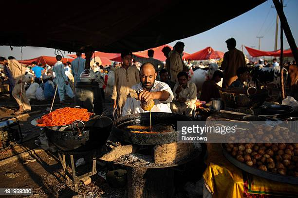 A vendor prepares sweets at a stall at a livestock market in Islamabad Pakistan on Thursday Sept 24 2015 The South Asian nation's consumer price...