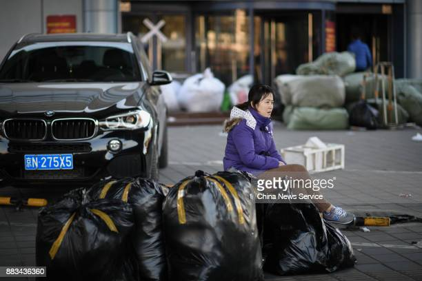 A vendor prepares to leave the Dongding wholesale market on November 30 2017 in Beijing China The Dongding market the last of 12 clothing wholesale...