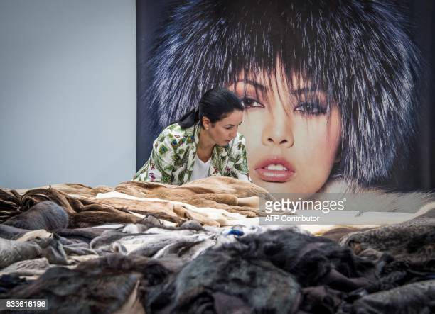 A vendor presents a collection of fur outfits during the international fashion fair Chapeau Mosfur 2017 in Moscow on August 17 2017 / AFP PHOTO /...