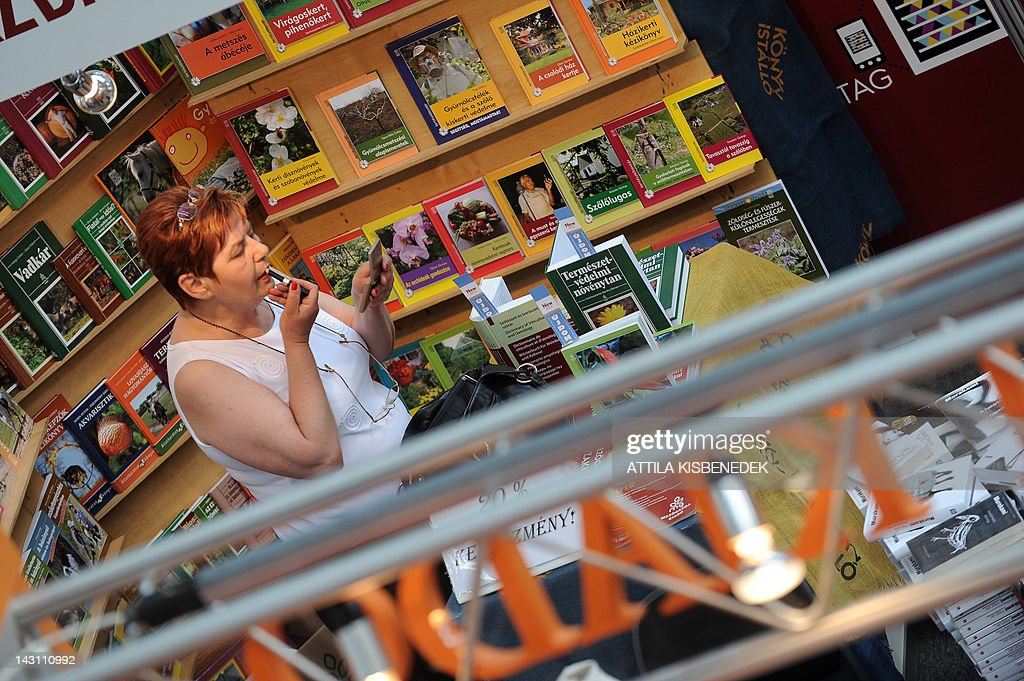 A vendor puts on make-up before the opening ceremony at the 19th International Book Festival (IBF), held in the Millenaris Culture Center in Budapest, on April 19, 2012. Budapest's 19th International Book Festival, one of the biggest in central Europe, opened today featuring popular Nordic writers as this year's guests of honour. More than 20 northern European writers will attend the four-day event in the Hungarian capital, including award-winning Swedish crime novelist Hakan Nesser, Norway's Jostein Gaarder, Danish author Janne Teller and Leena Lehtolainen from Finland.